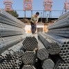 epa01865575 Workmen load steel tubes in a metals wholesale market in Shenyang, northeast China 18 September 2009. U.S. Steel has asked President Obama to impose 90% duties on imports of Chinese steel tubes which it alleges are being dumped at prices below the cost of production.  EPA/MARK